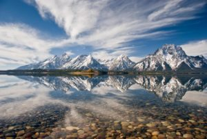 There is a thin line between the Tetons and their reflection that may someday change our lives.  Image captured by GJH vice-president John Hebberger, Jr.